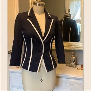 Blue blazer with white piping at the seams!